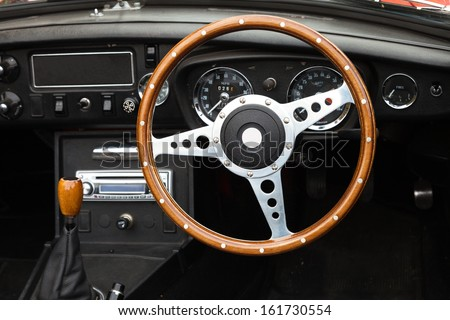 Wooden steering wheel from a MGB roadster sports car - stock photo