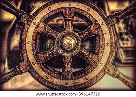 Wooden steering wheel of an old ship - stock photo