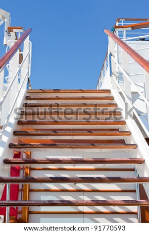 wooden steps and blue sky on cruise liner - stock photo