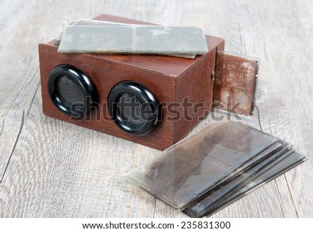 wooden stereoscope with glass plates on wooden table