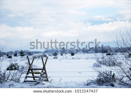 Wooden stile in a wintry landscape at the swedish island Oland