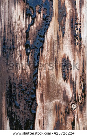 Wooden structure with black tar texture. - stock photo