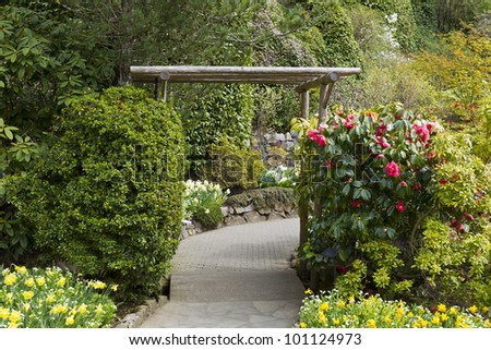 wooden structure with stone path leading into garden