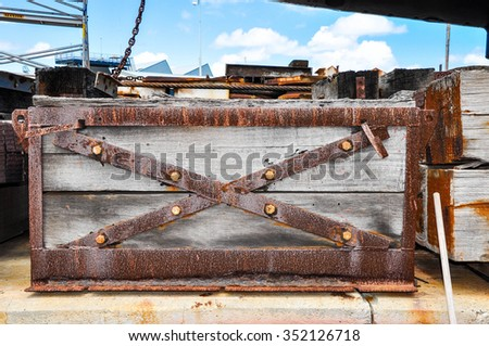 Wooden submarine chest with rusted metal details/Submarine Cargo Chest/Wood and rusted metal - stock photo