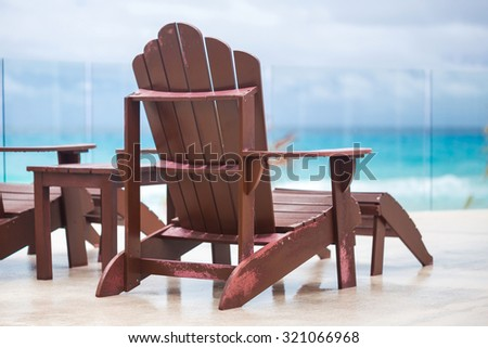 Wooden sun chair at luxury resort near caribbean sea, Cancun, Mexico
