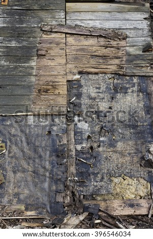 Wooden surface from pieces of rotten spotty wooden boards. planks and  panels. Abstract background - stock photo