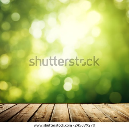 wooden surface in forest - stock photo