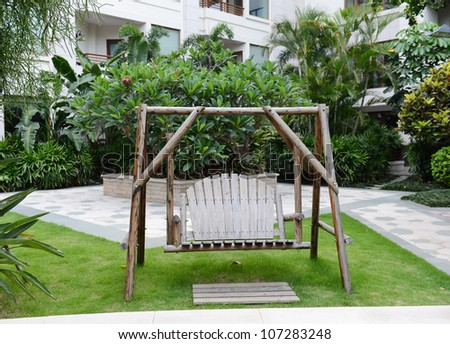 wooden swing in the backyard stock photo
