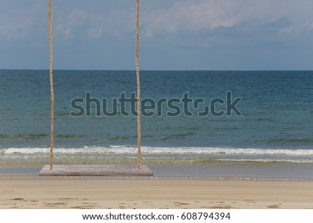 wooden swing on Beach and bright sky background.