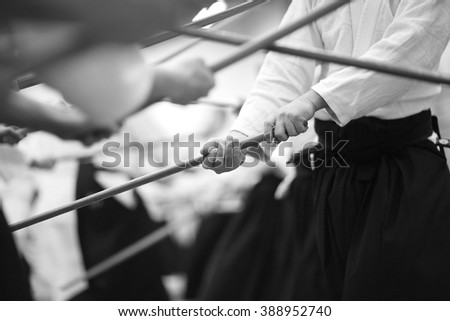 Wooden sword in hands of samurai - stock photo