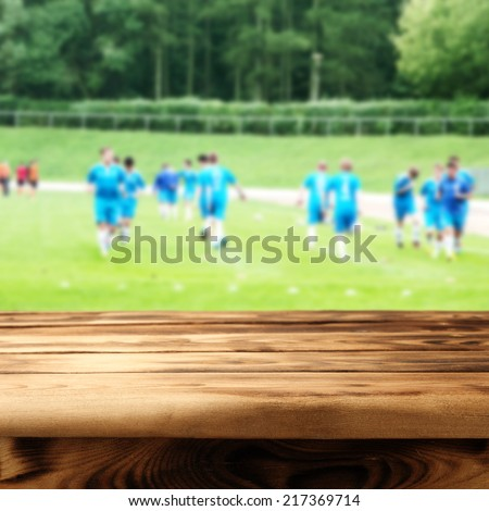 wooden table and arena of sport  - stock photo