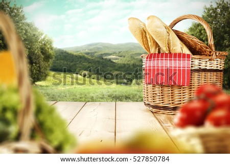 wooden table and basket with spring landscape