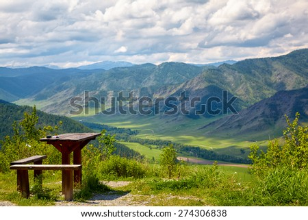 Wooden table and bench on the top of mountain pass Chike-Taman, Siberia, Russia - stock photo