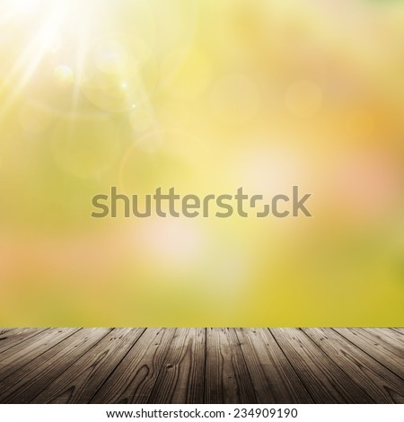 Wooden table and blurred green background - stock photo