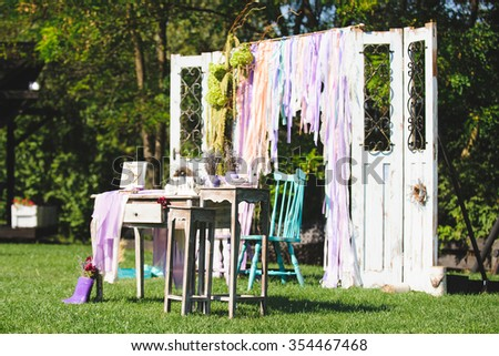 wooden table and chairs decorated in rustic style - stock photo