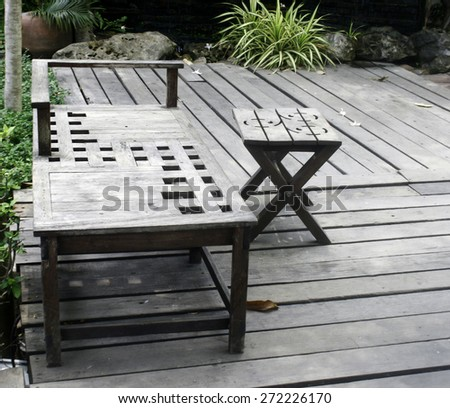 Wooden table and chairs in a garden