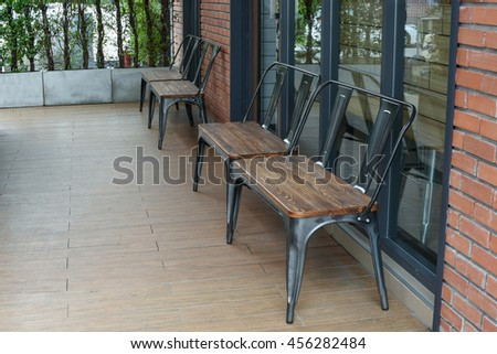 wooden table and chairs in the cafe. wooden chair and table at front porch.