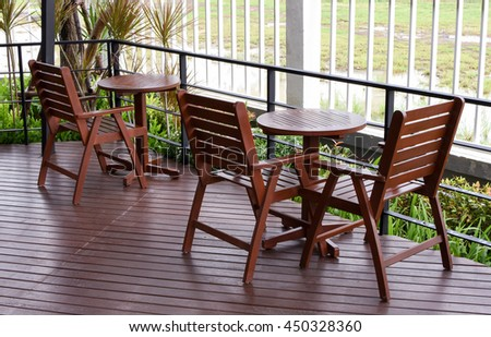 wooden table and chairs in the cafe. wooden chair and table at front porch. something on table in garden.