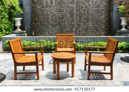 Wooden table and chairs in the garden