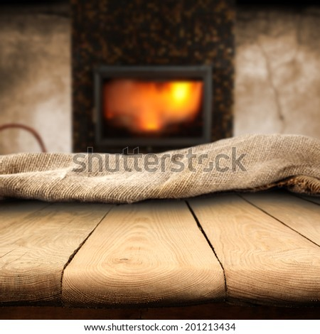 wooden table and fireplace space