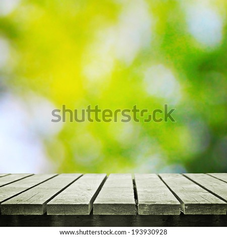 Wooden table and summer or autumn nature - stock photo