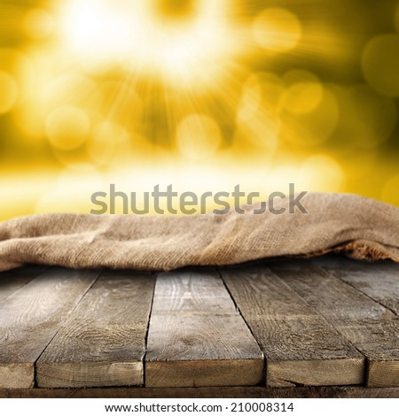 wooden table autumn time and sack  - stock photo