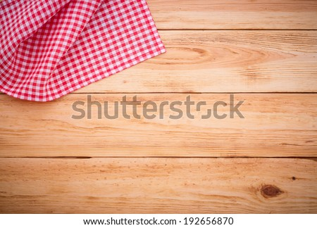 Wooden table covered with tablecloth. View from top. Empty tablecloth for product montage. Free space for your text  - stock photo