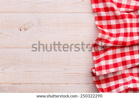 Wooden table covered with tablecloth. View from top texture wallpaper horizontal. Unique perspectives. Empty tablecloth for product montage. Free space for products and for your text - stock photo