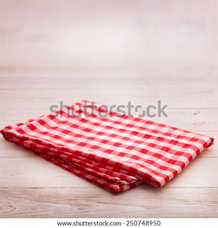 Wooden table covered with tablecloth. View from top texture wallpaper square. Unique perspectives. Empty tablecloth for product montage. Free space for products and for your text - stock photo