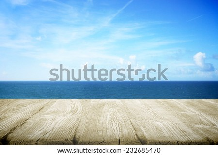 Wooden table for picnic on the beach - stock photo