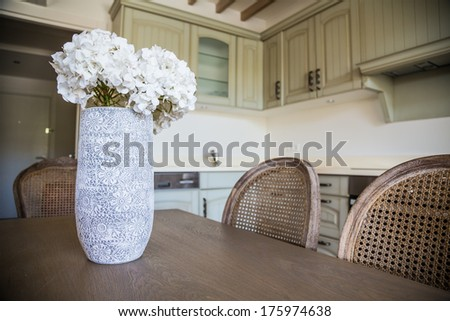 wooden table in a dining room of a house - stock photo