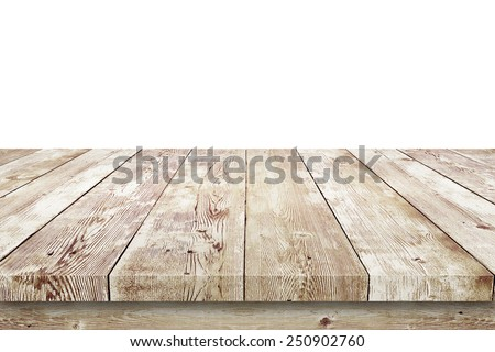 Wooden table isolated over white background - stock photo
