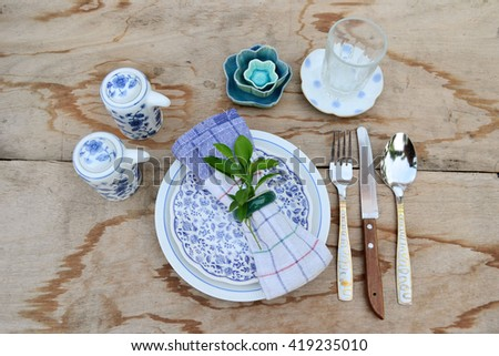 wooden table meal dish decoration idea - stock photo