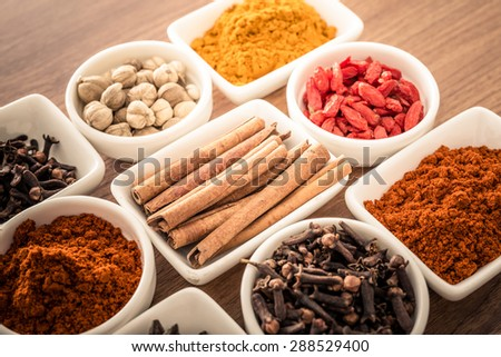 Wooden table of colorful spices - stock photo