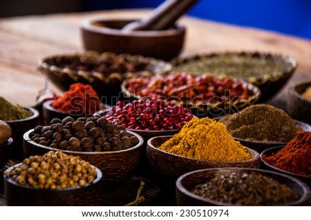 Wooden table of hot spices - stock photo