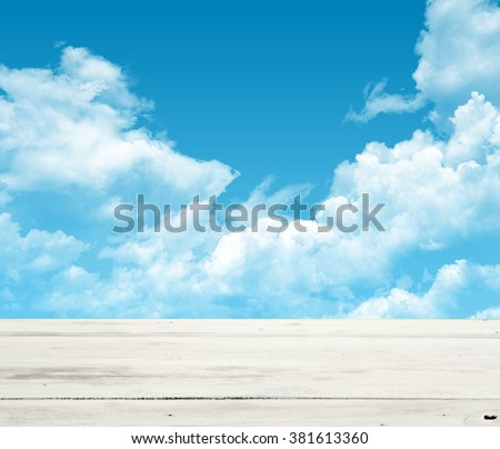 Wooden table on a background sky - stock photo