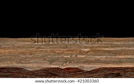 Wooden table on black background with clipping path - stock photo