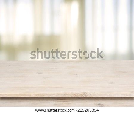 Wooden table on defocuced window with curtain background - stock photo