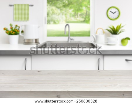 Wooden table on kitchen sink window background - stock photo