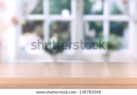 Wooden table on room background - stock photo