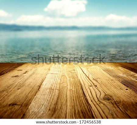 wooden table on the beach  - stock photo