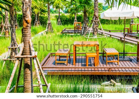 Wooden Table Set and Trees in The Park, Thailand. - stock photo