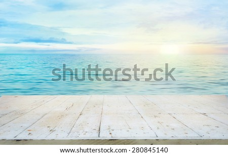 Wooden table. Summer background. Ocean with sunset. Wood planks for your montage - stock photo