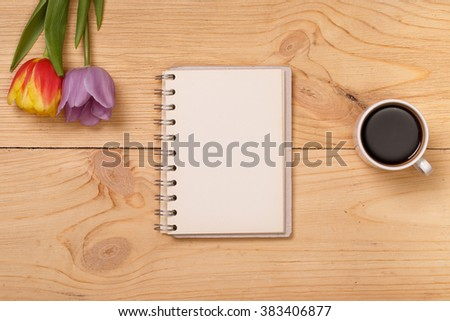 Wooden table, top view on workplace. Lilac tulips. Post blog social media 8 march. Banner template mockup for woman day. View from above with copy space for birthday. Mother day layout card.