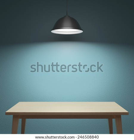 Wooden table under the lamp behind the wall - stock photo