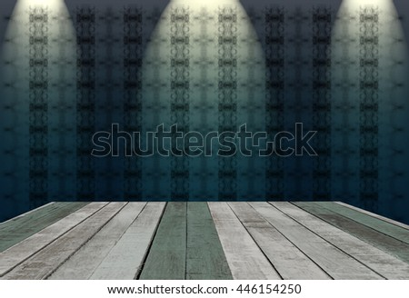 wooden table with abstract background in dark room illuminated by 3 spots