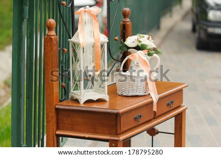 wooden table with decoration elements in yard