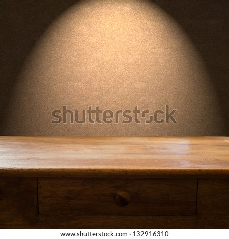 Wooden table with drawer and light backdrop - stock photo