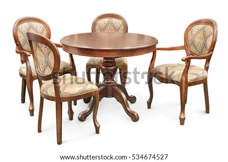 wooden table with four color chairs