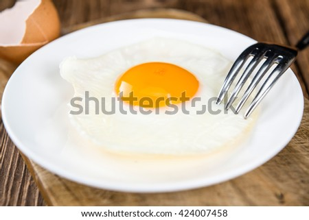 Wooden table with Fried Eggs (selective focus; close-up shot) - stock photo